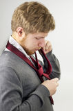 Guy Tying Tie Royalty Free Stock Photos