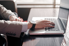 The guy typing on the laptop. Royalty Free Stock Image
