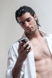 Guy typing a text message on cellphone. Isolated Royalty Free Stock Image