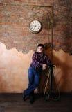 Guy under hours stock photos