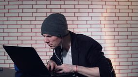 A guy uses a laptop. 4k stock footage