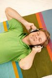 Guy using headphones Royalty Free Stock Photography