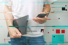 Guy using smartphone and digital tablet, modern mobile electroni Royalty Free Stock Photos