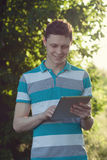 Guy using a tablet pc stock image