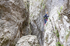 Guy in a via ferrata over the rocks Royalty Free Stock Images