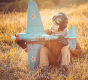 Guy in vintage clothes pilot with an airplane model outdoors Stock Image