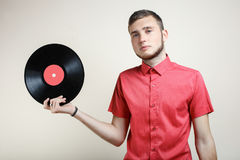 Guy with a vinyl record Stock Image