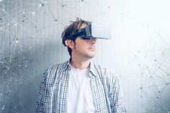 Guy with VR goggles. Watching 3d multimedia content Stock Photo