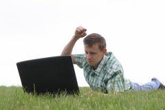 Guy vs. laptop. Technology vs. man Royalty Free Stock Photos