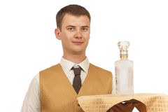 Guy waiter with a bottle of vodka on a tray Stock Photography