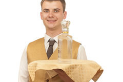 Guy waiter with a bottle of vodka on a tray Stock Images