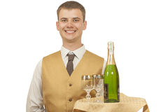 Guy waiter with champagne on a tray Stock Photo