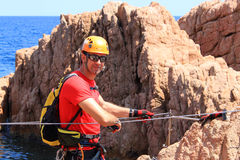 Guy waiting on a via ferrata Stock Photography