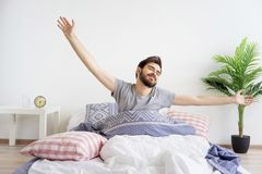 Guy is waking up Royalty Free Stock Image