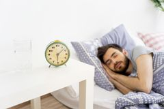 Guy is waking up. A portrait of a guy waking up in the morning Stock Photos