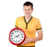Guy with wall clock Royalty Free Stock Images