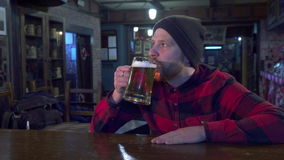 Guy watching game at the pub stock footage