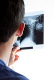 Guy watching neck radiogram Royalty Free Stock Photo