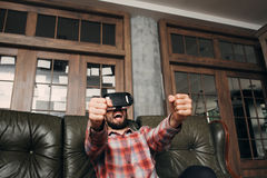 Guy watching sport game in 3d vr glasses Royalty Free Stock Photo