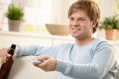 Guy watching tv Royalty Free Stock Photo
