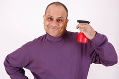Guy with water spray bottle Stock Photos