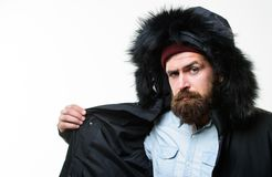 Guy wear black winter jacket with hood. Prepared for weather changes. Winter stylish menswear. Winter outfit. Man. Bearded stand warm jacket parka isolated on stock image