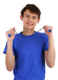 A guy wearing a blue shirt with a skipping rope Royalty Free Stock Photo
