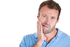 Guy wearing blue shirt with tooth ache Royalty Free Stock Images