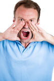 Guy wearing blue shirt and yelling angry Royalty Free Stock Image