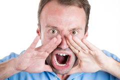 guy wearing blue shirt and yelling angry Royalty Free Stock Photography