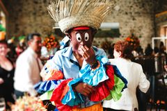 Guy wearing a caribbean carnival costume and funny mask in a party royalty free stock photos