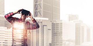 Guy wearing checked shirt and virtual mask demonstrating shock o Stock Photography