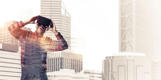Guy wearing checked shirt and virtual mask demonstrating shock o Stock Images