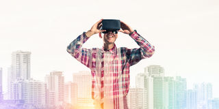 Guy wearing checked shirt and virtual mask demonstrating some em Stock Images