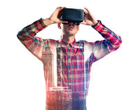 Guy wearing checked shirt and virtual mask demonstrating some em Royalty Free Stock Photography