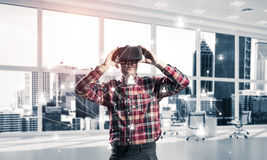 Guy wearing checked shirt and virtual mask demonstrating some em Stock Photography
