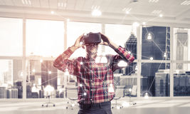 Guy wearing checked shirt and virtual mask demonstrating some em Royalty Free Stock Image