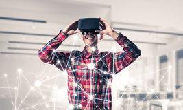 Guy wearing checked shirt and virtual mask demonstrating some em Stock Photo