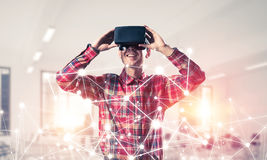 Guy wearing checked shirt and virtual mask demonstrating some em Stock Photos