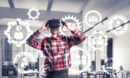Guy wearing checked shirt and virtual mask demonstrating some em Stock Image