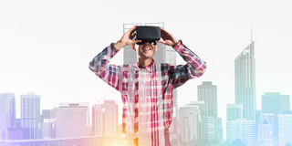 Guy wearing checked shirt and virtual mask demonstrating some emotions Stock Photo