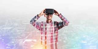 Guy wearing checked shirt and virtual mask demonstrating some emotions Royalty Free Stock Photos