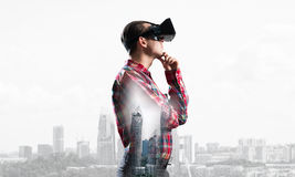 Guy wearing checked shirt and virtual mask with hand on chin Stock Photography
