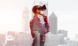 Guy wearing checked shirt and virtual mask with hand on chin Stock Photos