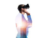 Guy wearing checked shirt and virtual mask with hand on chin Royalty Free Stock Photo