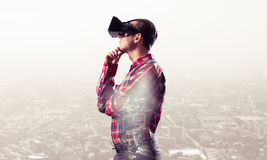 Guy wearing checked shirt and virtual mask with hand on chin Royalty Free Stock Photos