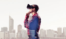Guy wearing checked shirt and virtual mask with hand on chin Royalty Free Stock Photography