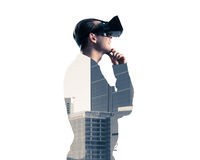 Guy wearing checked shirt and virtual mask with hand on chin Royalty Free Stock Images