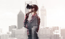 Guy wearing checked shirt and virtual mask with hand on chin Stock Images