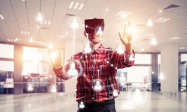 Guy wearing checked shirt and virtual mask reaching hand to touc Stock Images